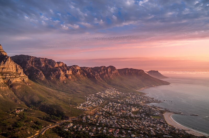 View of Camps Bay Beach from Lion's Head at sunset